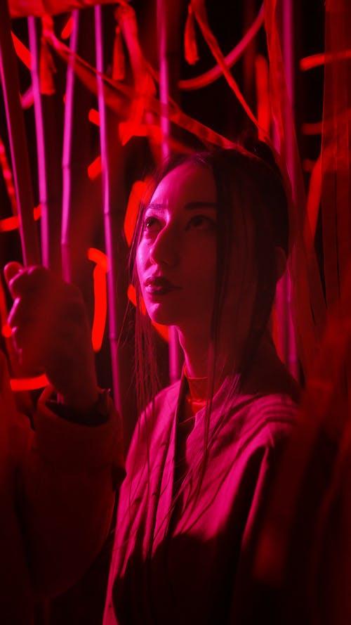 Woman in Kimono Under Red Light