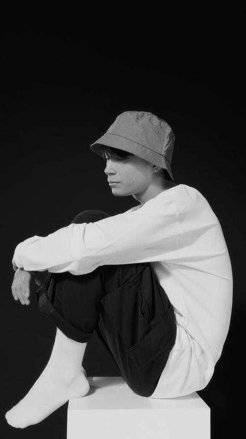Black and White Video of a Man Wearing a Bucket hat