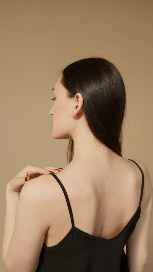 Young Woman Touching Her Back