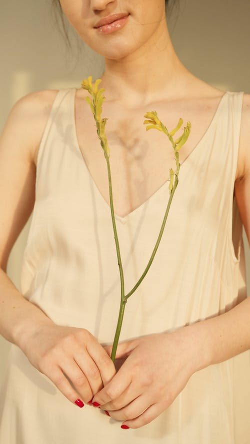 A Woman Holding a Flower