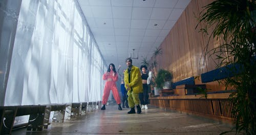 A Man Rapping with Dancers in a Music Video