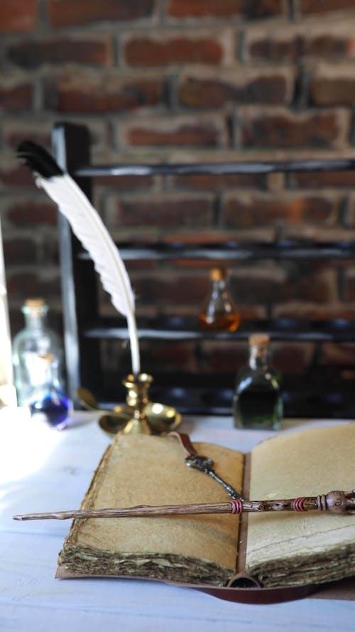 A Magic Wand on an Open Book