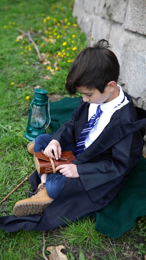 Young Boy Opening a Book