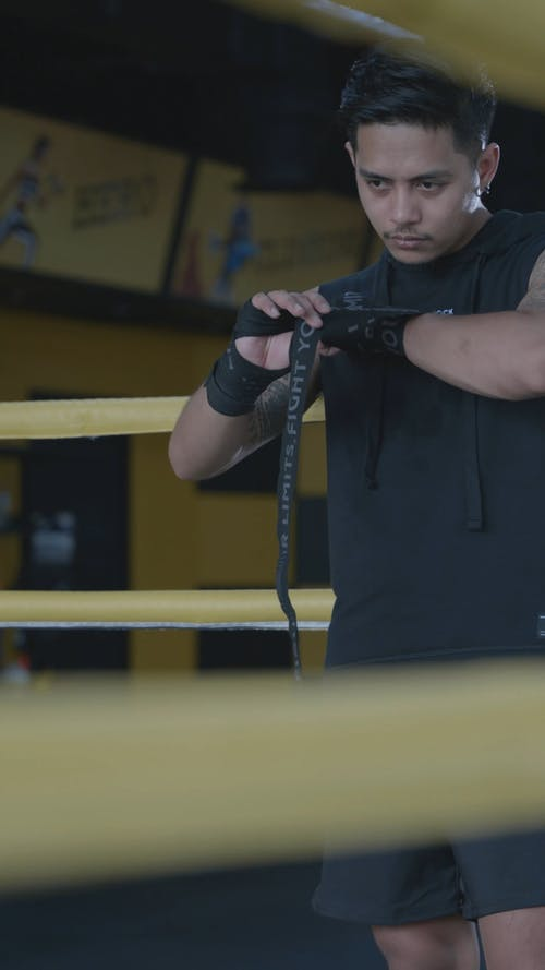 A Man Putting On Hand Wraps