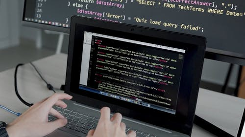 Man Coding in His Laptop