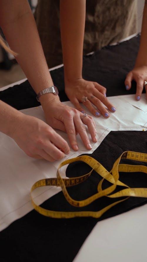 Women Using a Stencil on Fabric