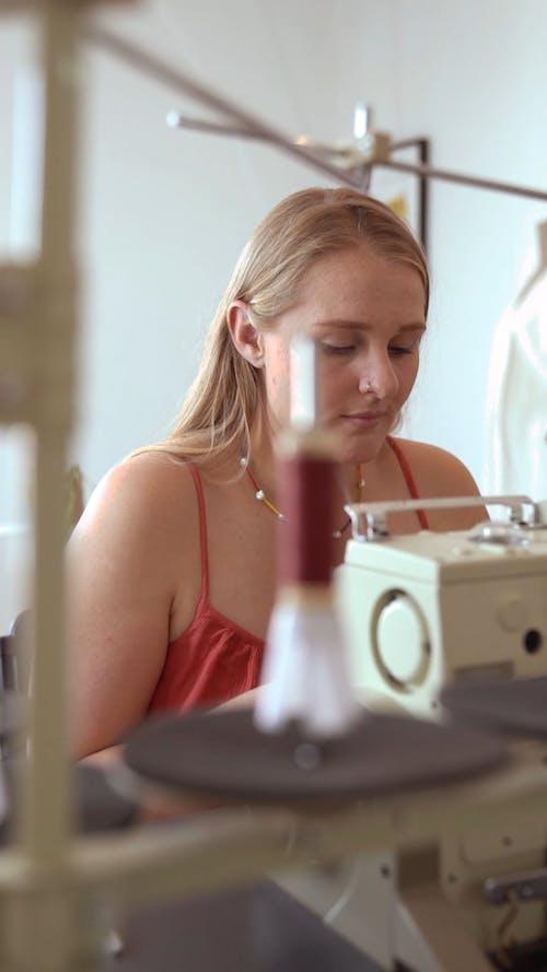 A Woman using a Sewing Machine
