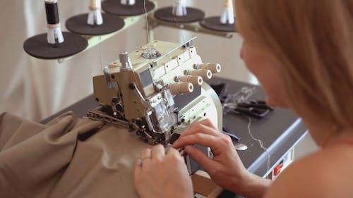 Woman Sewing Fabric