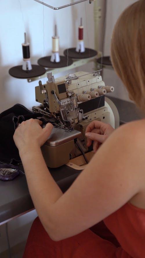 A Dressmaker Working