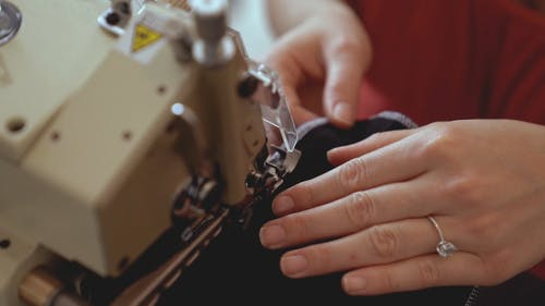 Close Up of a Woman Using a Sewing Machine