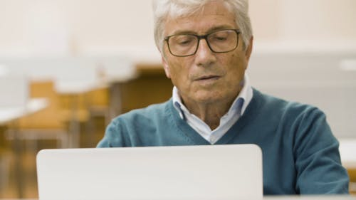 Elderly Men Learning How to Use a Laptop