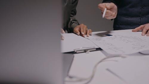 Crop People Sketching on Paper