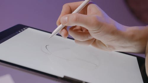 Person Sketching on Digital Board