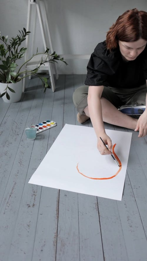 A Woman Painting with Watercolors