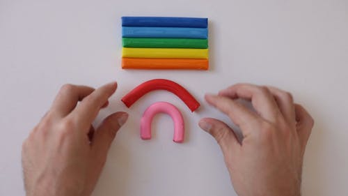 A Person Using Clay to make a Rainbow