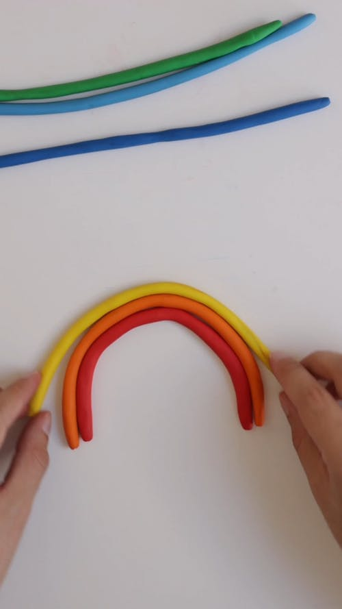 A Person Making a Clay Rainbow