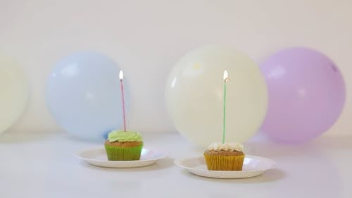 Cupcakes with Candles and Balloons