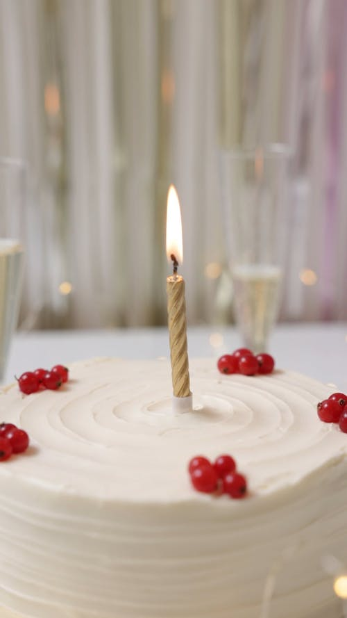 Close Up Video of a Burning Candle on a Cake