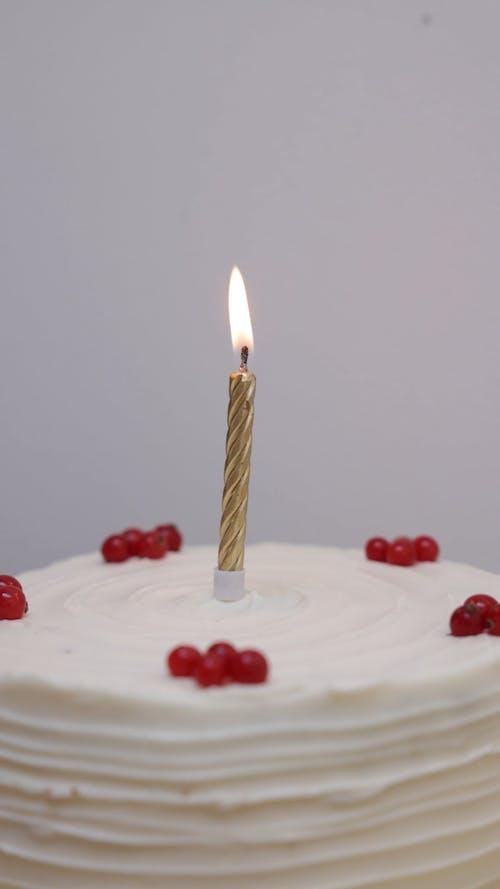 Burning Candle on a Cake