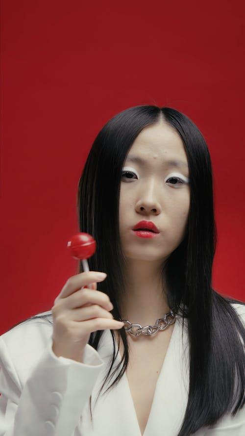 A Woman Eating Lollipop