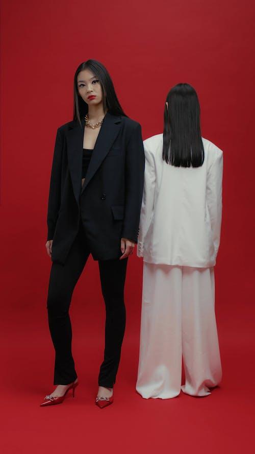 Women Posing and Looking at a Camera