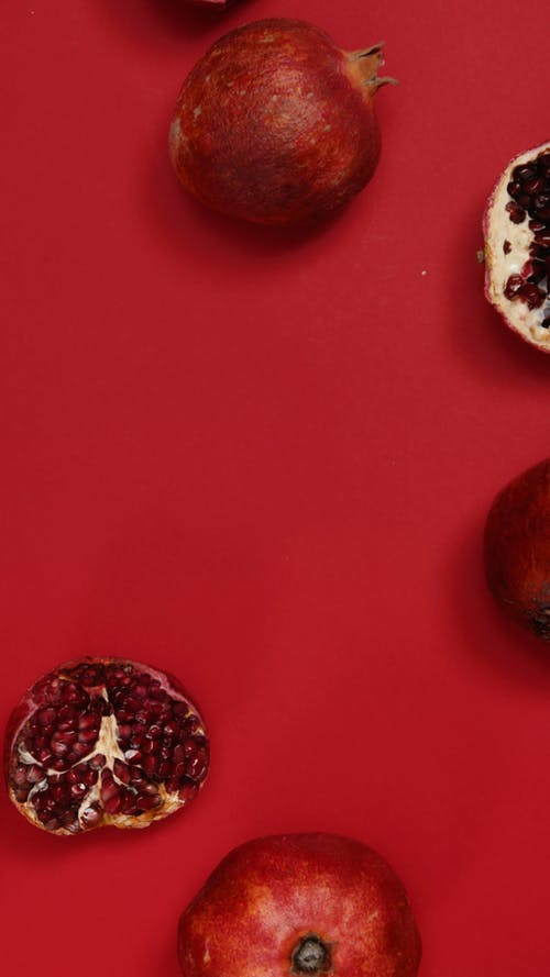 A Sliced and Whole Pomegranate