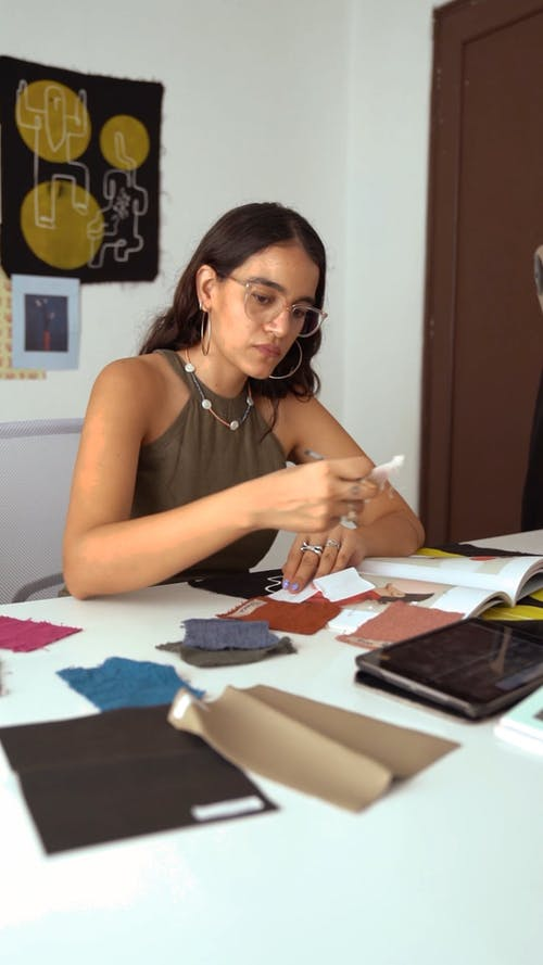 A Woman Looking at Swatches on a Table