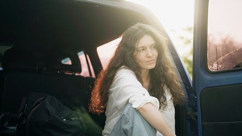 Woman Sitting on the Car