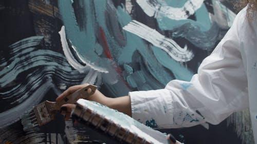 An Artist Doing Painting