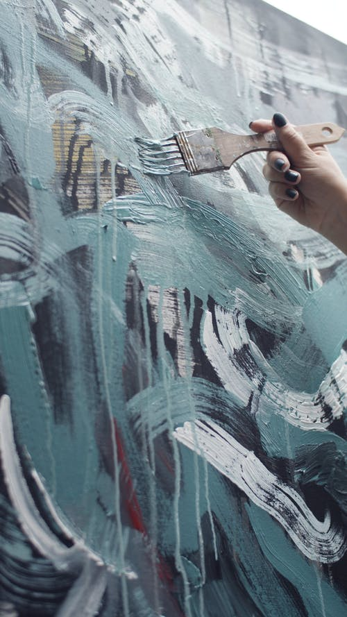 An Artist Doing Abstract Painting