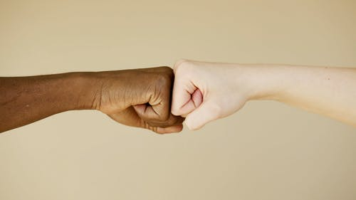 Fist Bump of Two People