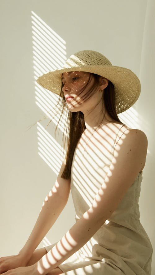 Woman Wearing Beach Hat Posing for the Camera