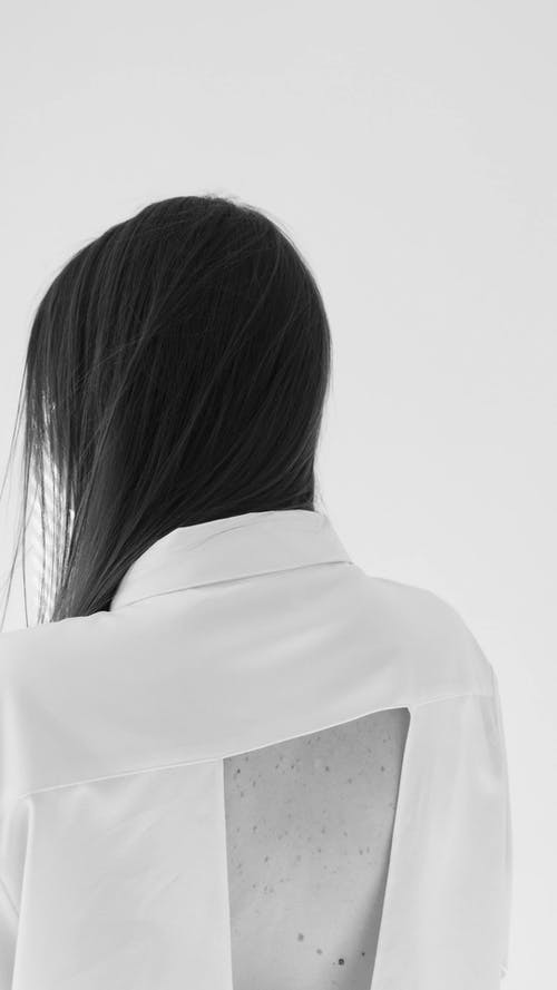 A Model Wearing a Backless Top while Posing