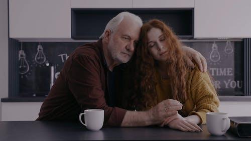An Elderly Man Comforting a Woman