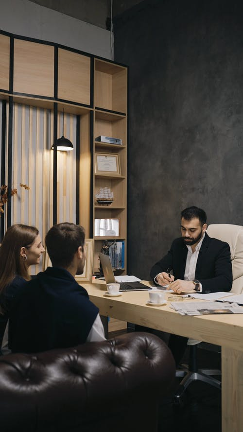 Businessman In A Meeting With His Customers