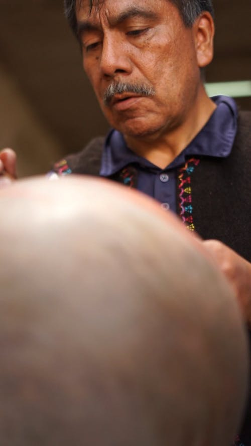 A Man Painting a Pot