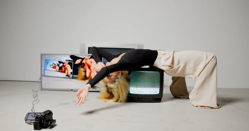 Video of Woman Lying on top of CRT Television