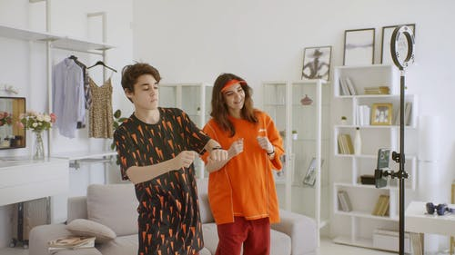 Mother and Son Dancing while Video Recording using Smartphone