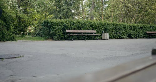 Homeless People Resting on a Bench