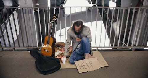 A Homeless Man on a Bridge