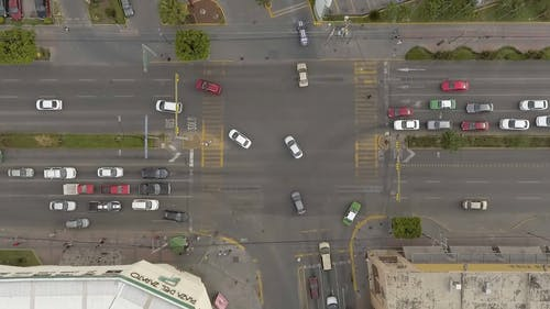 Drone Footage of Automotives Moving in the Crossroad