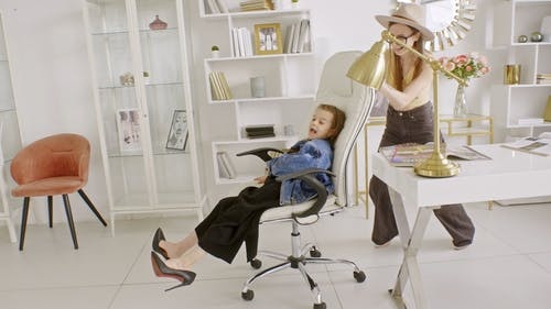 Mother and Daughter Playing in the Office