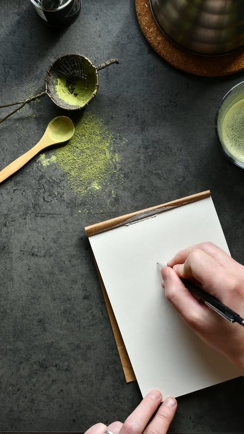 Person Drawing on a Sketchpad