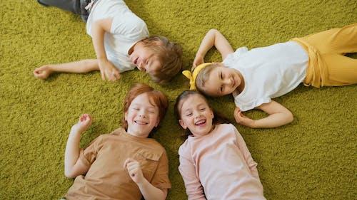 Children Lying Down on the Floor