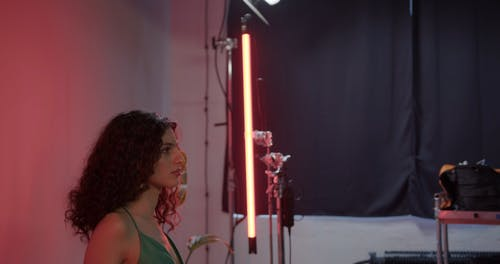A Makeup Artist Fixing Actress Hair