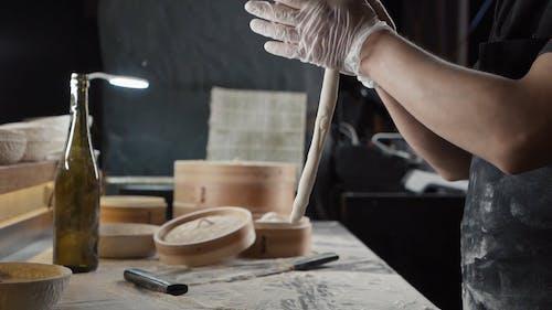 Chef Cutting a Dough