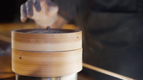 Man Cooking Dumplings