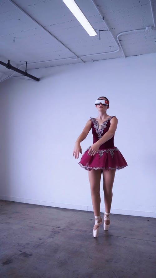 A Ballerina Dancing while Wearing a VR Headset