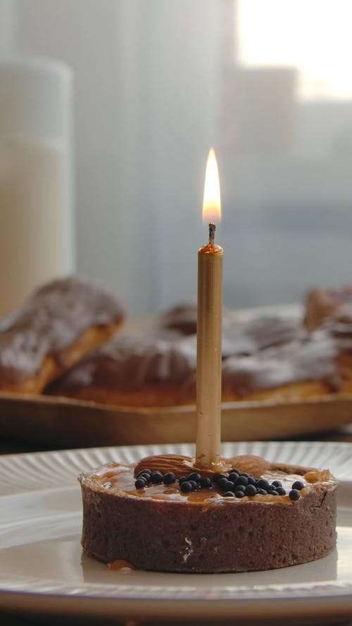 A Birthday Cake with Lighted Candle