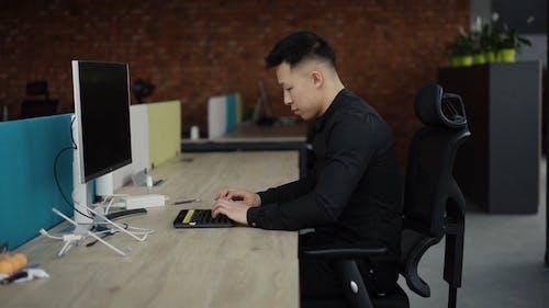 Man using Laptop while Working